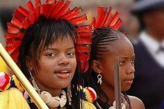 Members of the Swazi Royal Family, indicated by red feathers in their head dress, at the annual reed dance ceremony.