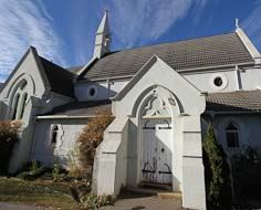 The Holy Trinity Anglican Church and Coulter Cross in Kokstad's Main Street.
