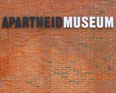 The symbolism-laden black and white lettering of the Apartheid Museum's entrance signage.