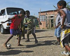 Township kids playing street soccer