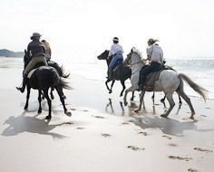 Horse-riding on the beach near St. Lucia on the KwaZulu-Natal North Coast.