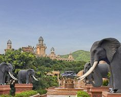'The Bridge of Time' flanked by huge elephant statues at the Sun City Resort in the North-West Province. In the distance is visible The Palace of The Lost City Hotel.