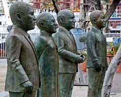Group of statues in Cape Town's V&A Waterfront depicting four Nobel Peace Prize Laureates - Luthili, Tutu, De Klerk & Mandela.