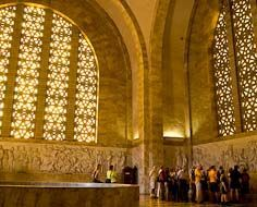Visitors listen as their guide epxlains the history depicted in various freezes inside the Voortrekker Monument.