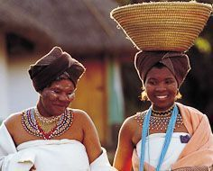 Ladies at Lesedi Cultural Village in tradtional Xhosa dress as a bride and family member.