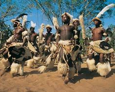 Zulu men performing traditional dances at a cultural village.