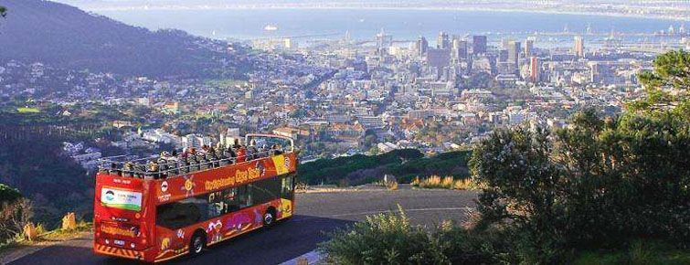 A Citysightseeing open-top bus above Cape Town