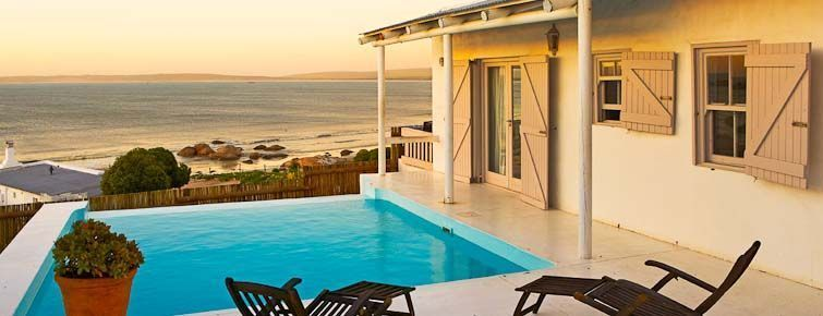 Paternoster Seaside cottages - pool and view